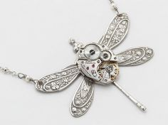 Steampunk jewelry Steampunk Necklace vintage watch movement silver dragonfly pendant flower with pearl & Swarovski crystal Statement Gift Art Steampunk, Steampunk Earrings, Dragonfly Necklace, Dragonfly Pendant, Hp Lovecraft, Bullet Casing Jewelry, Steampunk Accessories, Watch Necklace, Disc Necklace