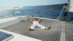 http://media.gettyimages.com/videos/lying-on-the-catamaran-trampoline-video-id157064861?s=640x640