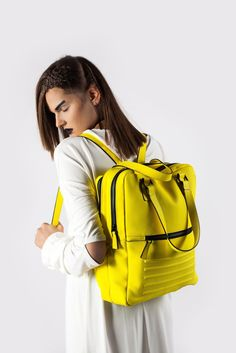 """Yellow minimal, two in one unisex backpack-rucksack. Is divided into two separate sections. 100% Italian leather, perfectly fits 15"""" Macbook, made in Europe."""