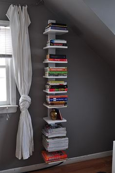 Love the wall color, curtains and especially the bookshelve