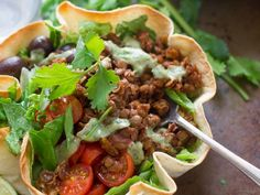 A spicy mix of lentils and walnuts is served up over greens in a crispy tortilla bowl to make this scrumptious vegan taco salad!