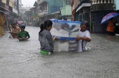 """IMPACT: """"Philippines needs a climate change awareness campaign. Advertising and media agencies discussed the vital role of the industry in building critical mass awareness for climate change the day after Tropical Storm Trami left the country in devastation. Photo: Reuters"""""""
