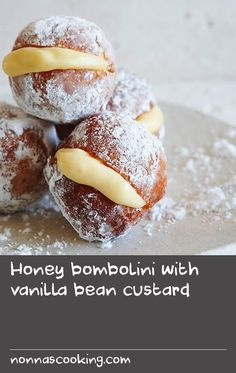 Honey bombolini with vanilla bean custard | These doughnuts use a sweet yeast dough made with honey instead of sugar. The honey helps the yeast to prove and gives them a delicious flavour. They are cut into small rounds and once cooked they are rolled in icing sugar and then a slit is cut on the side and filled with custard.