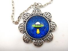 Hey, I found this really awesome Etsy listing at https://www.etsy.com/listing/187059081/hand-painted-ufo-necklace-spaceship