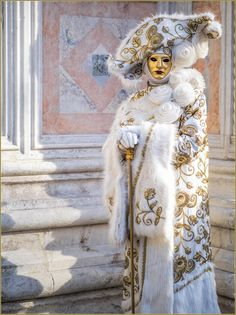 A very regal looking costume in white with gold flower motif....spectacular ~ Carnival of Venice 2016