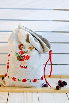 This natural colored handmade linen pouch is excellent for packaging anything. It is also great for wedding favors, as a makeup bag, travel pouch, lingerie bag, cosmetic bag. Also great for storing food like rice, tea, coffee beans, and peanuts. The drawstring bag is hand embroidered by Veronique Enginger design - red poppies and a little girl with a basket. Available in my Etsy shop.