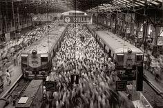Sebastião Salgado Churchgate Station, Bombay, India, 1995 - Notice the two unmoving people of hundreds