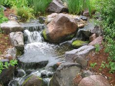 A beautiful waterfall by The Bruce Company. Garden Waterfall, Pond Water Features, Beautiful Waterfalls, Wishing Well, Fire Pits, Ponds, Koi, Landscape Design, Planting Flowers