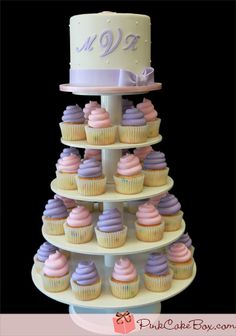 Christening Cupcake Tower | http://blog.pinkcakebox.com/christening-cupcake-tower-2012-06-01.htm