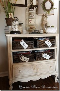An old dresser/cabinet without drawers - replaced with baskets & painted & glazed.
