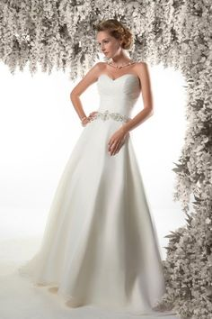 CHRISTINE DANDO DESIGNS. Dorothy Lamour inspired wedding Gown. Simple, Dreamy elegance Fitted Pleated Bodice With Sweetheart Neckline And Organza Covered Button To The Hem Of The Train. Pearl And Crystal Beaded Waist Band
