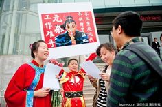 A girl calls for equal opportunity to get a job for women, supported by ancient female hero in the history.