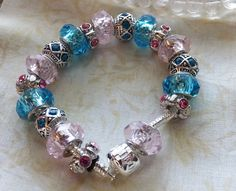 Royal Court - Lady in Waiting, A European Style Charm Bracelet with 18 pieces of Teal, Pink, and Silver Faceted Beads by BlingItOutLoudCharms on Etsy