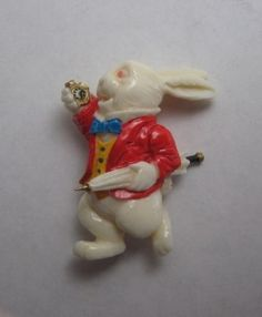 ButtonArtMuseum.com - Carved Painted Bone White Rabbit Checking Watch Button or Pin Alice Wonderland