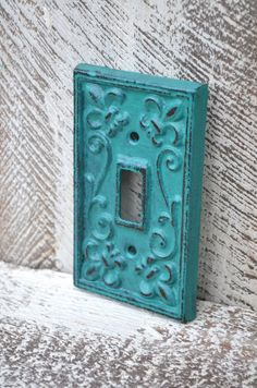 Just bought this from DiamondintheRust on ETSY. It looks great in my office/craft room for my soon to open TealBlueCottage ETSY shop! From DiamondinthRust:  Light Switch Cover - Teal Switch Plate Cover - Fleur de Lis Switch Plate - Scroll Design - Cast Iron Turquoise Decor Youth Bedroom Decor