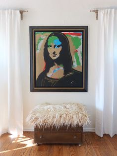 """One of the only available wall spaces in the master bedroom has been assigned to a Mona Lisa painting, made by a student of Andy Warhol. Sharlene and Kevin bought the piece at a local auction for """"less than the price of the frame, which is how the auctioneer promoted it."""""""
