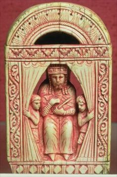 King chess piece, showing an enthroned figure in a curtained alcove with two attendants, Italian, late 11th century (ivory)