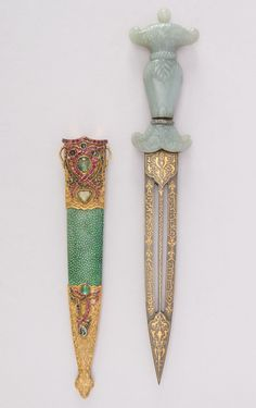 Dagger with Sheath Dated: 18th century Culture: Turkish Medium: jade, steel, gold, copper, shagreen, gemstone Measurements: L. with sheath 14 5/16 in. (36.4 cm); L. without sheath 13 5/16 in. (33.8 cm); W. 2 1/2 in. (6.4 cm); Wt. 9.1 oz. (258 g); Wt. of sheath 3.7 oz. (104.9 g) Source: Copyright 2014 © The Metropolitan Museum of Art