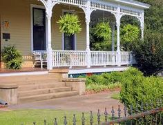 I love hanging ferns on porches- they're my favorite!! And I want this porch!!