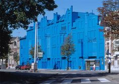 Florentijn Hofman Beukelsblauw. This was once one of the most unseen blocks of houses in Rotterdam, and by applying a layer of only 2 micron of blue paint onto it, it became Rotterdam's most photographed one. By redecorating this block, which was built in the first years of the 20th century, people start looking again at what was and is there, and maybe think about what they will get in return.