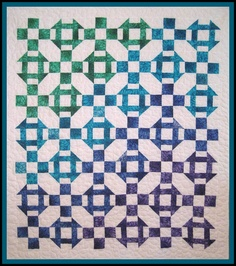 Fantastic color fades in this quilt by Mary Manson made from alternating Nine Parch and Churn Dash blocks.