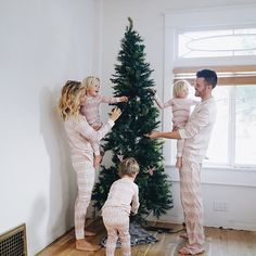 Couldn't wait one more second to put up the Christmas tree and surprise our boys with our matching @burtsbeesbaby Jammies! And I'm going to make sure this family tradition sticks around. So excited for this Christmas season! #familyjammies