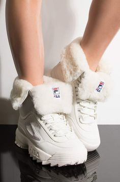 The FILA Womens Disruptor Shearling Boot spices up winter fits by combining an ankle height, shearling lined shaft with a chunky sneaker base. Wedge Sneakers, Platform Sneakers, Fila Sneakers Womens, Fila Outfit, Fila Disruptors, Winter Fits, Fresh Shoes, Hype Shoes, Shearling Boots