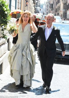 Happy couple:Alex Kingston married TV producerJonathan Stamp at theAll Saints Anglican Church in Rome, Italy on Saturday