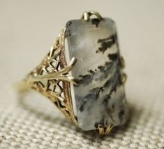 Moss agate ring with gold filigree setting, American c. I need to have the band on my grandma's moss agate ring either repaired or reset entirely. This is a very pretty option. Jewelry Box, Jewelry Rings, Jewelry Accessories, Jewelry Design, Jewellery Earrings, Jewellery Shops, Cheap Jewelry, Jewelry Ideas, Wedding Jewelry