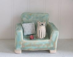 Happy Dog on Green Chair Ceramic Sculpture by dreamingdogs on Etsy, $45.00