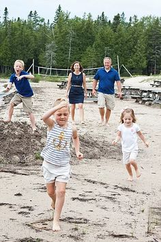Fun beach family photo. Let the kids be kids!  #family #photography #kids #beach #play #running #parents