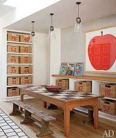 Hank Azaria's son has one beautiful playroom. Featured in the June 2011 issue of Architectural Digest, the room is filled with numbered  storage baskets (in no particular order), a rustic farmhouse table, and Enzo Mari's La Mela Poster. Source: Architectural Digest