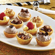 The Pampered Chef - Build Your Own Cookie Bar...   Bake up these Mini Cookie Cups using refrigerated cookie dough and set out lots of sweet and fruity toppings. Your company will love crafting a treat that's just for them!