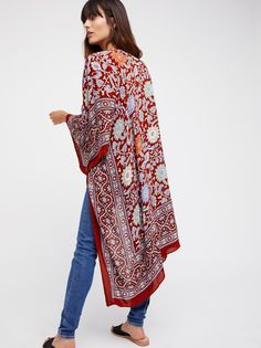 Magic Dance Border Print Kimono   Lightweight kimono featured in a colorful pattern with a border print. Make a statement with this bold style.