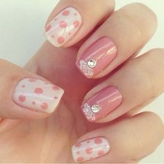 Cute pink and cream nails with polka dots and rhinestones!