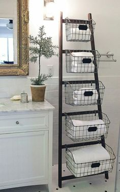 Vintage Home Wood Ladder with 5 Wire Baskets - Why We Love It Who ever said ladders are for climbing? Our stylish metal ladder with wire baskets is cute, creative and perfect for those looking for extra storage. Diy Storage Ladder, Ladder Decor, Extra Storage, Storage Ideas, Storage Solutions, Ladder Shelves, Storage Design, Ladder Display, Wood Display