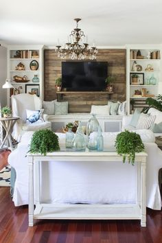 Rustic coastal living room for summer with white, aqua, and fresh plants: