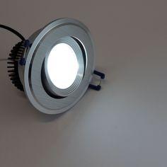 Downlight LED basculante empotrable 6 Watios con aro. Incluye sistema de sujeción y driver externo, para sustitucion de dicroicas. Carcasa visible exterior de color aluminio. http://www.barcelonaled.com/downligth-led-para-empotrar/459-downlight-led-basculante-empotrable-6w-para-sustitucion-de-dicroicas.html