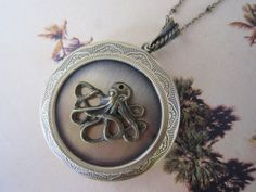Hey, I found this really awesome Etsy listing at http://www.etsy.com/listing/150335732/round-bronze-locket-necklace-octopus