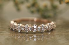 ♥♥♥ Free Shipping ♥♥♥ This charming garland style diamond band features natural round brilliant cut diamonds set in a unique 2:1 pattern 3/8 of the way round the band! A trusted small family business, Diamond Dove jewelry has been hand-crafting jewelry since 1996. All of our diamonds and gemstone are meticulously hand picked (by mom) for quality and excellence. We strive everyday for exceptional craftsmanship, and the happiness of our customers. Thats why all of our pieces are 100% Ameri...