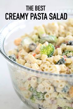 The Best Creamy Pasta Salad | Six Sisters' Stuff The absolute BEST Creamy Pasta Salad made with broccoli, cucumbers, olives, cheese, red onion, red pepper, and broccoli then tossed in a sweet and tangy dressing. This is the perfect pasta salad for parties and potlucks! #pastasalad #sixsistersrecipes #potluckrecipes #creamy #saladrecipes