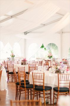 frame tent with cathedral sides, hardwood flooring, chivari chairs