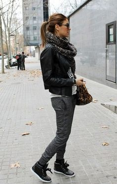 Women's Black Studded Leather Biker Jacket, White and Black Print Crew-neck T-shirt, Charcoal Sweatpants, Black Leather High Top Sneakers