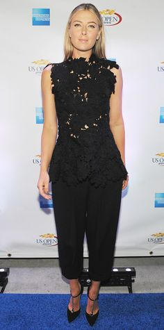 Maria Sharapova revealed glimpses of skin at an American Express-hosted event with a sexy black lace peplum Max Mara top paired with matching tapered trousers and patent black T-strap pumps.