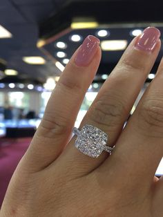 Up for sale is a beautiful 18K White Gold Cushion Shape Cluster Diamond Halo Engagement Ring. Round Brilliant Diamond weight 1.30 carats. Color: F Clarity: SI1 Specifications: -Model #: SJ3064CLUS -Metal Type: White Gold -Metal Purity: 18K -Gold Weight: 2.7 Grams -Band Width: 2MM