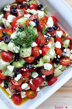 Tomato Cucumber Salad with Olives + Feta - 1 lb tomatoes, 1 lb cucumbers, 1/2 c olives, 1/2 c feta cheese, 2 T fresh dill. Dill  Garlic Dressing: 1/2 c olive oil, 1/4 c red wine vinegar, 1 1/2 t sugar, 1 clove garlic, 1 T fresh dill, 1 t dried oregano, 1/2 t garlic powder, 1/4 t salt, freshly ground black pepper.