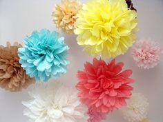 Decorate your party with pretty pom poms. I wouldn't want to take these down after the party is over.