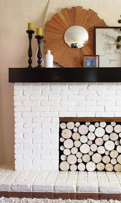 This faux log fireplace facade allows you to easily remove and replace the logs in a few seconds! Can you guess the trick?  Source: Pepper Design Blog