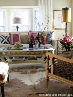 Adding a touch of radiant orchid to neutrals, cowhide rug, mix of pillows ikea, greek key, ikat, Home Depot   plant