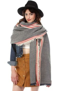 The frayed hem adds rustic flair to ensembles, while bold stripes promise standout style. Striped Jeans, Striped Scarves, Blue Denim, Fall Scarves, Bold Stripes, Blanket Scarf, Womens Scarves, Raincoat, Clothes